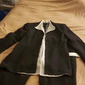 Black pants suit with white gauze accents in jacke